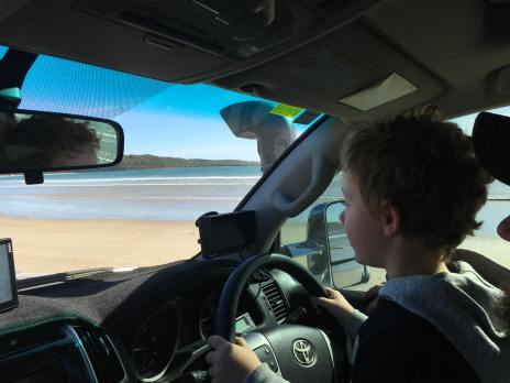 Mitchell having a drive on the beach with Andrew
